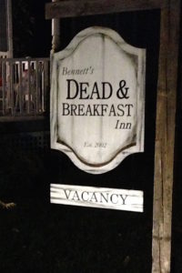 dead and breakfast halloween sign at night